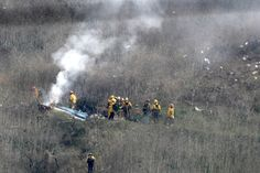Emergency workers are seen sifting through the smoldering wreckage of the Sikorsky helicopter in this grim photo from the scene of the crash. Orange County, Kobe Bryant News, Saudi Military, Living In Belize, Last M, Emergency Responder, World Wide News, Ivy Park, Sports Figures