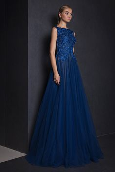 Midnight Blue evening gown with embroidered bodice, boat neckline and a Tulle skirt.