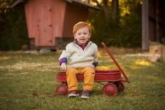 He had the perfect fall outfits! I love the outdoor fall sessions! His family's photoshoot was a blast! We were celebrating his 1  year birthday! The red wagon made for the perfect prop!