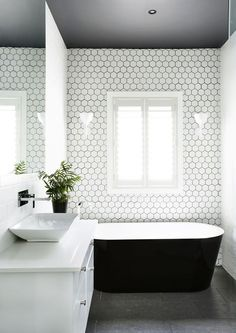 Contemporary bathroom that looks calm and serene. Love the hexagonal tiles in particular.
