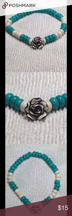 Lovely Natural Turquoise Rose Bracelet I love turquoise! It's a gorgeous stone and looks great with anything. This is made with blue and white turquoise, and an adorable clay rose bead. One size fits all! PeaceFrog Jewelry Bracelets