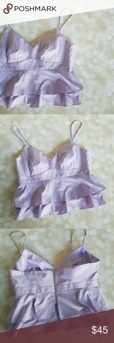 Lilac Purple Peplum Crop Top Purchased from someone else online.  I only tried it on once since purchasing, ended up being too small for me. Zips in back. Double layer peplum style top. Has very small snag on front of top, otherwise, great condition! Nanette Lepore Tops Crop Tops