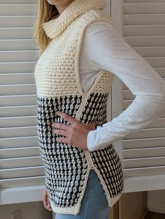 This beautiful cowl neck crocheted vest will keep you warm and on trend this fall and winter.