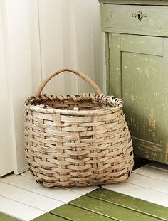 Worn basket that reminds me of the one that always sat in the porch.