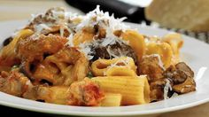 "Rigatoni woodsman style, with mushrooms, sausage, onion, tomatoes and peas, from ""Lidia's Mastering the Art of Italian Cuisine"" by Lidia Bastianich and Tanya Bastianich Manuali. (Michael Tercha / Chicago Tribune)"