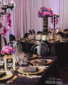 Nothing completes a table quite like a dramatic #centrepiece and we're partial to these arrangements housed in custom tall, #ArtDeco-inspired vases. They give the bursting blooms that extra dramatic flair. See more from this #1920s-esque #wedding on WedLuxe.com today!   Photography by: Mango Studios, Planning and design: La Chic Soirée, floral: Art of Celebrations   WedLuxe Magazine   #wedding #luxury #weddinginspiration #floral