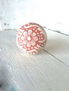 These beautiful ceramic knobs make a wonderful accent to any dresser, cabinet, or jewelry box. Ceramic material with a metal screw on base. Shown in Coral and Creamy White, with a matte finish. Handmade Accessories, Home Decor Accessories, Decorative Knobs, Ceramic Knobs, Ceramic Materials, Creamy White, Decor Styles, Jewelry Box, Dresser