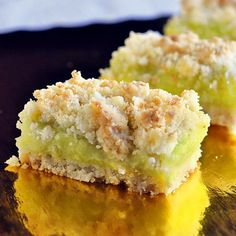 Coconut Lime Crumble Bars - my original old family recipe had lemon in the center but coconut and lime go so well together, I thought this would be delicious. I wasn't wrong!! Just the right balance of sweet and tart with a buttery coconut crumble. Perfect for the Christmas freezer too!
