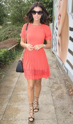 Busy woman:Lucy Mecklenburgh  looked stunning as she headed to work at Lucy's Boutique, her clothing store in her native Essex on Saturday