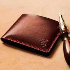 This one of a kind burgundy vegetable tanned slim leather wallet is simply stunning. Leather Gifts, Leather Bags Handmade, Cow Leather, Real Leather, Leather Gloves, Slim Leather Wallet, Slim Wallet, Men Wallet, Custom Mens Wallets