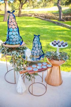 Macaroon Towers  Delicious Desserts   Dessert: 2tarts Photo: Lyndsay Lyon Photography Dress/Jewelry: Beatitude Bridal Boutique Makeup: Kara Sanchez Beauty Flowers: Weddings By Robbins Hair: The Lady Armstrong Paper Products: Ever After Calligraphy   Styling: Touch of Whimsy