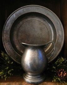 This is a plate and jug made out of pewter, the material we are planning to make a pendant out of (which will then go on the end of a necklace). This looks like a very nice metal that we look to draw inspiration from. Verona, Country Primitive, Primitive Decor, Country Sampler, Primitive Antiques, Primitive Christmas, Country Christmas, Rustic Decor, French Country House