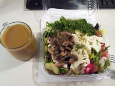 Lunch. Mostly-purchased salad (microwaved the mushrooms!) and home-made juice (carrot, celery, apple, pear, bell pepper, broccoli and cauliflower stalks, lemon, ginger, etc.)