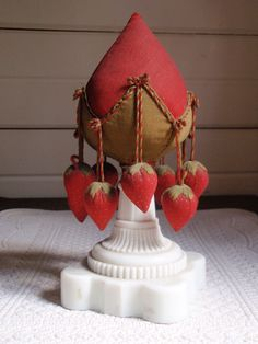 The BEST old strawberry make- do pin cushion.  www.thecatladyantiques.com