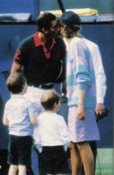 Charles shares a kiss with Diana as their sons look on.