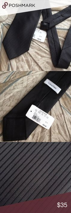 NWT Calvin Klein Solid Black Tie Diagonal Stripes Excellent condition.smoke free home. No stains rips or holes. 100% silk. Label says king cord solid. Perfect for prom wedding or formal event like a funeral. Classy. Professional. Business attire. Suit. Homecoming. Fancy. Dance. Tango. Calvin Klein Accessories Ties