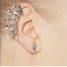 Crystal Earcuff New Crystal Earcuff. Top part clips on and bottom is for pierced ears. No trades. Jewelry Earrings