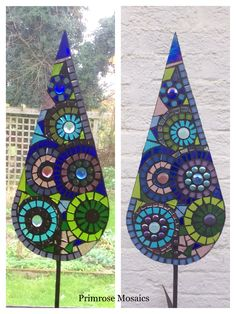Art for the garden. Concentric circle design - teardrop sculpture. Glass mosaic garden sculpture. Handcrafted personalised gifts for gardeners. www.primrosemosaics.com