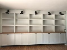 All about how we DIY'd our built in bookshelves using IKEA cabinets. Living Room Built In Cabinets, Living Room Built Ins, Home Office Cabinets, Bookshelves In Living Room, Ikea Cabinets, Bookshelves Built In, Living Room Storage, Storage Cabinets, Bookcases