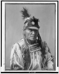 Forked Iron  1 photographic print. | Head-and-shoulders portrait of Crow man.  Contributor:Curtis, Edward S. Original Format:Photos, Prints, Drawings Date:1908