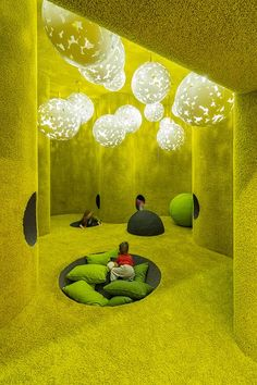 Green coziness space. Idea of pillows on the ground for a recreational space.
