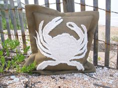 "A Crabby Pillow I found this on boutique-de-la-mer.com -     Each handmade Crab Throw Pillow is made with 100% natural elements, down filled pillows, finished with a (still salty) oyster shell that was picked up on Ponte Vedra Beach, Florida    • 18"" square with oyster shell closure  • Feather/down blend insert      Each accent pillow is Handmade in the USA by Pillow Folly in Surfside Beach, SC."