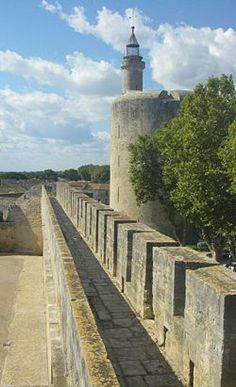32 k from Nimes  Aigues-Mortes is a town in the Languedoc-Roussillon region in southwest France, with well preserved medieval city walls surrounding a historical centre.