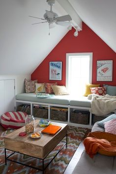 beam in attic and place space under window. Twin bed along other window.
