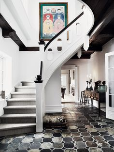 Love the floor and interesting architectural details. Great Artwork placement in this stairwell.