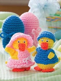 Easter Eggs Crochet Pattern Download from e-PatternsCentral.com -- These holiday eggs contain a hidden surprise -- adorable little boy and girl ducklings dressed for Easter!