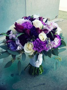 Purple and white wedding bouquet     tulips  white roses  purple carnations   purple stock