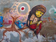 I know the fading probably wasn't part of the original idea, but I can't help to see it as a positive addition to this heart-wrenching piece. It adds a new layer for me, a new terrifying and sorrowful layer to an already heart-breaking piece. Here is a girl clearly weighted down with whatever horrors occupy her mind. Here is a girl, sitting on the tree of life that's home to all of these eyes and a bird painted a calming blue. Here is a girl who is sharing her misery in hopes of having it…