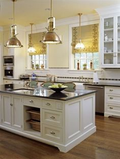 Interior Styles and Design: Kitchen Islands - Multi-Functional Centers - the chairs on the wrong side I think - but this would be what I would want if I could add on to my kitchen side of the house!