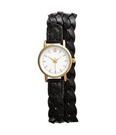 Schwarz. Armbanduhr aus Metall mit schmalem, verstellbarem Lederimitat-Armband…