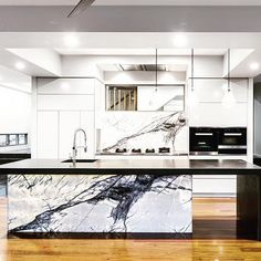 by Designer Kitchens West End - PITT cooker with a New York marble back-lit splash back. available @winningappliances