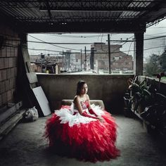 Laura Cristina Zarta in her quinceañera dress: | This Photographer Shows The Sacrifices Families Make For A Quinceañera