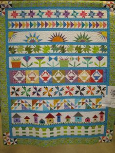 A strip row quilt using paper piecing and traditional piecing.