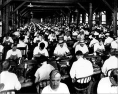 Ybor cigar rollers ply their craft c.1920. Note Lector on elevated reading platform, background right
