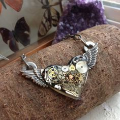 Handmade Steampunk gear/cog necklace Purchased from artist; watch parts, gears, and cogs set in resin; metal heart with wings; great condition; great for cosplay, goth, or punk styles Handmade Jewelry Necklaces