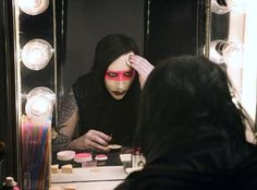 One of our biggest #DyeHard fans, Marilyn Manson, is shown here applying his favorite cosmetic, our #VampyresVeil pressed powder!