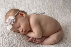 Sweet August Studios is located in Denver, CO. In home studio posed newborn portraits. Denver newborn photographer.