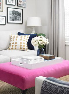 modern room with a gorgeous pink ottoman.
