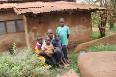 One of the Uganda based team with the foundation's new children.