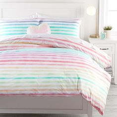 Designed for the playful, the Rainbow Stripe Organic Duvet Cover brings a burst of color to your space. Crafted of pure organic cotton, this duvet cover offers a whimsical layer that gets softer with every wash. Complete the look with our Rainbow … Girls Duvet Covers, Organic Duvet Covers, Twin Size Duvet Covers, Duvet Sets, Rainbow Bedding, Rainbow Bedroom, Teen Girl Bedrooms, Big Girl Rooms, Beach House Decor