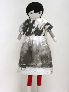 I wasn't quite on board for the idea of taking photographs and turning them into fabric. But this iteration of the idea looks great! I suppose it's the nature of the photograph (i.e., moody, black and white, with a horse...) that makes it work. Cute dress on cute doll by Le Train Fantome.