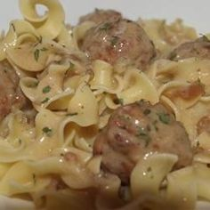"""My friend Anna makes the most amazing and easy meatballs with gravy! Prepared in a slow cooker, this recipe couldn't be any easier! Serve over buttery hot cooked noodles and you'll have a happy crowd! Mangia!"""