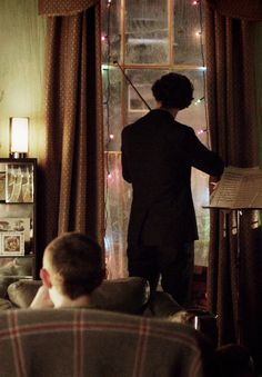 Christmas at 221B. [Meanwhile, on the streets below, the Doctor is running around causing mayhem.]