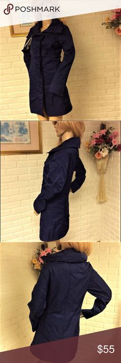 """Rainforest Ruffle Front Rain Coat with Hidden Hood This style-savvy coat offers a lightweight feel with a classicsilhouette.   This ruffle coat by Rainforest features a stand up collar, button front, and front slip pockets. The coat also features a zip away hood in thefunnel collar. Material is waterresistant and lightweight.    The color is cobalt; the size is small.  The measurements (lying flat) are: Length: 31"""" Bust: 17""""  *Brand new condition; with original tags attached…"""