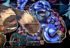 http://www.photaki.com/picture-urban-art-wall-painted-blue-bear-and-man_257558.htm
