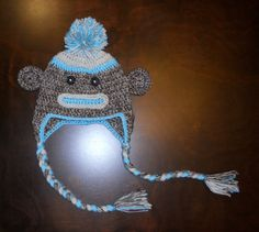 Hey, I found this really awesome Etsy listing at https://www.etsy.com/listing/105879559/blue-sock-monkey-earflap-handmade